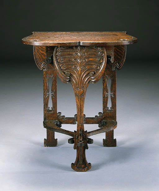 AN IMPORTANT CARVED OAK TABLE | CHARLES ROHLFS, 1901 | Christie's