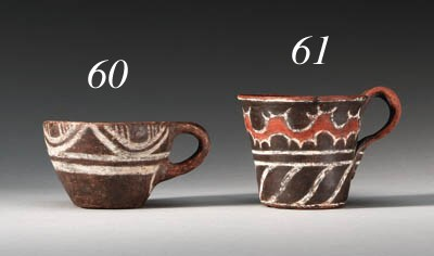 A MINOAN WHITE-ON-DARK POTTERY