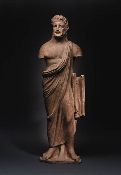 A LARGE ETRUSCAN TERRACOTTA ST