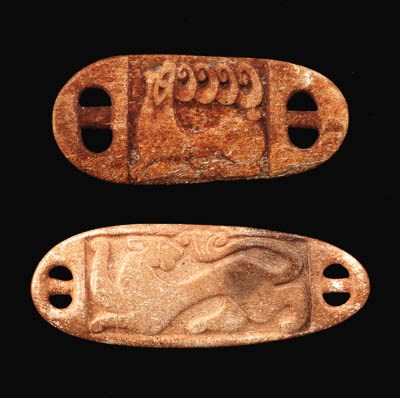TWO SCYTHIAN HORN WRIST GUARDS