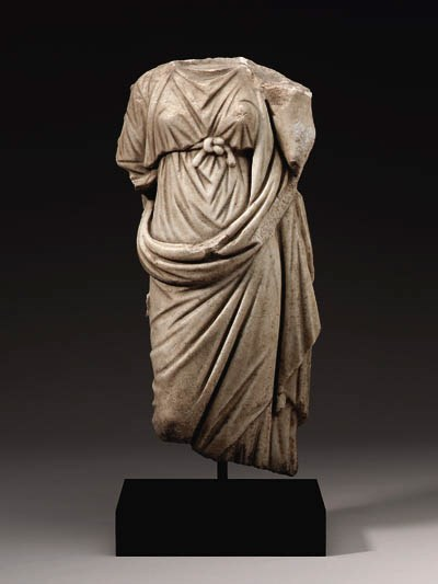 A ROMAN MARBLE FIGURE OF TYCHE