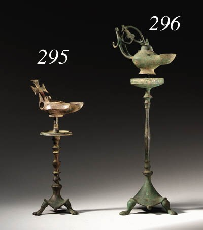 A BYZANTINE BRONZE LAMP AND ST