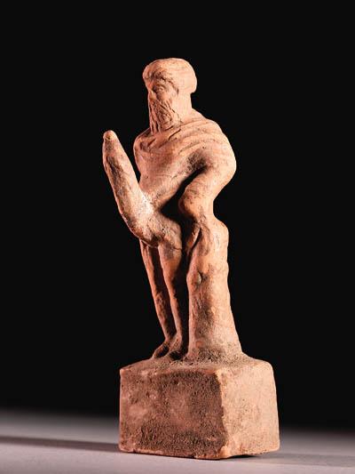 A GREEK TERRACOTTA FIGURE OF PRIAPUS