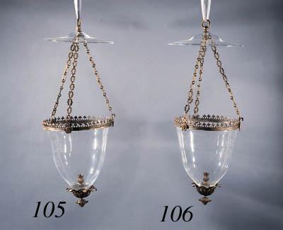 A gilt-metal and glass hundi l