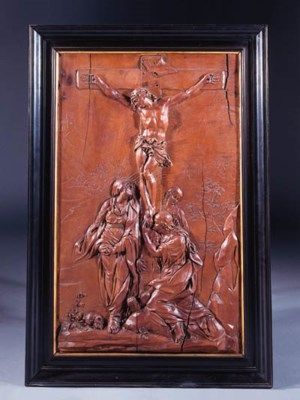 A carved wooden relief of the