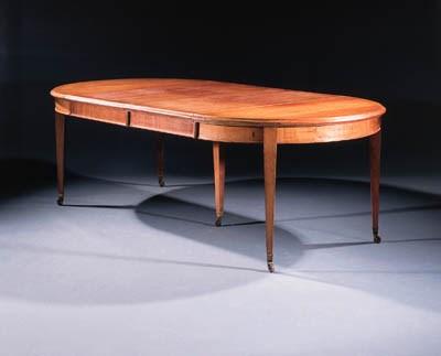 A mahogany extending dining-ta