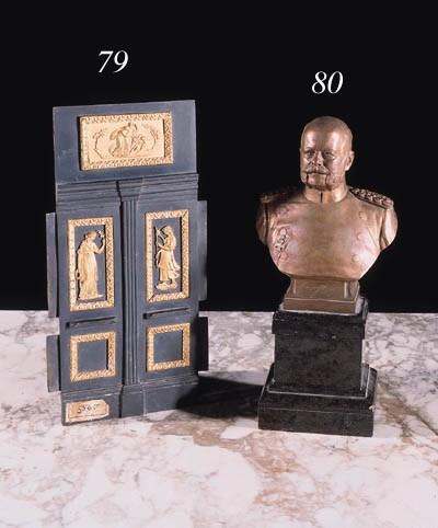 A bronze portrait buste of a g