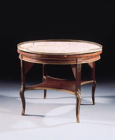 A gilt-metal mounted mahogany