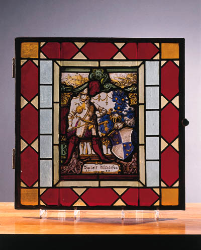 two stained-glass dated panels
