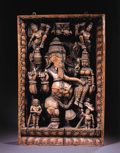 a south indian wood panel carved with ganesha