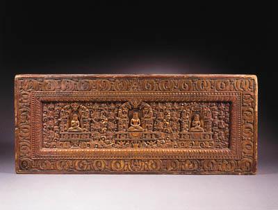 a tibetan gilt-wood book cover