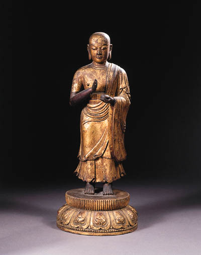 a tibeto chinese gilt-wood figure of an arhat