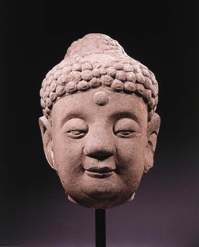a chinese, ming dynasty, stone head of buddha sakynamuni