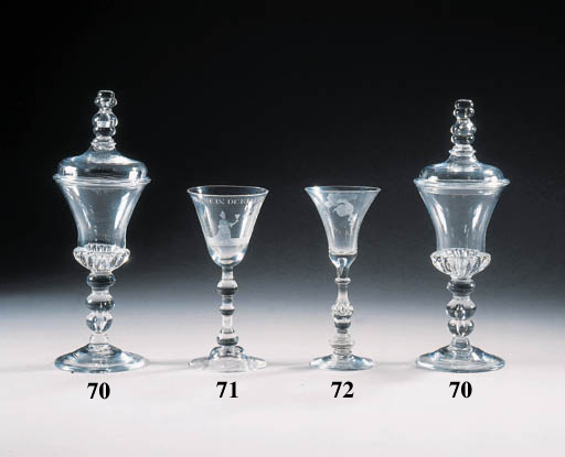 a pair of goblets and covers