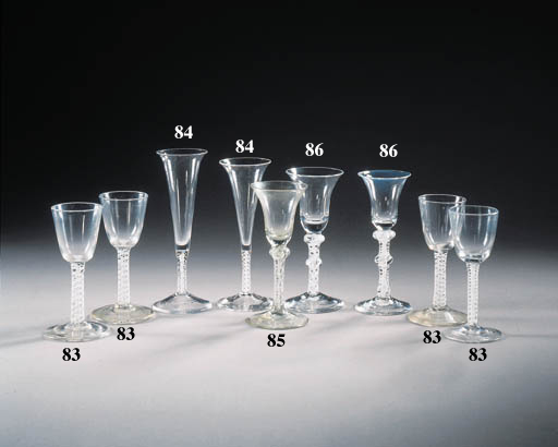 three opaque-twist wine glasse