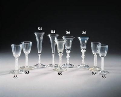 three opaque-twist wine glasse
