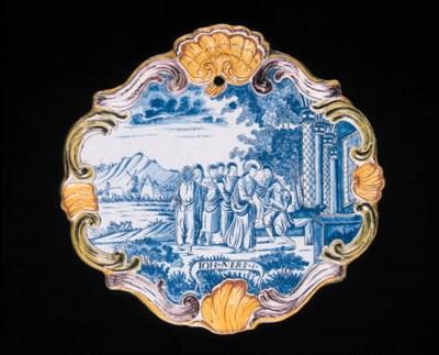 a dutch delft biblical plaque