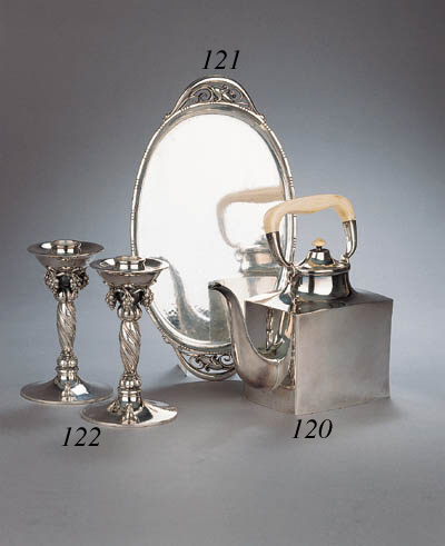 A Danish silver teapot with iv