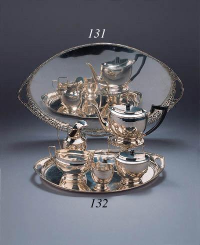 A Dutch six piece tea service on a matching tray