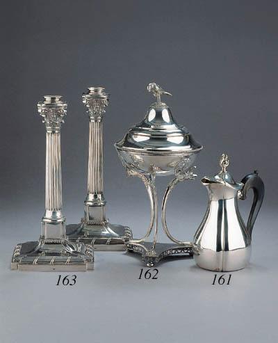 A small silver mocha pot