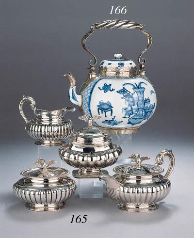 A Dutch three part silver tea service and a non-matching tea caddy