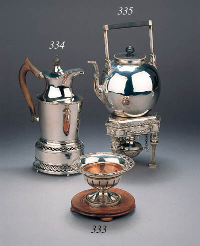 A Dutch silver tea kettle on s