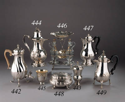 A German four-piece silver and parcel-gilt oil- and vinegar stand with two cut-glass bottles and stoppers and a pair of salt cellers