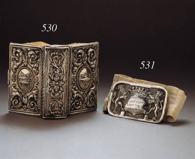 A silver Yom Kippur belt buckl