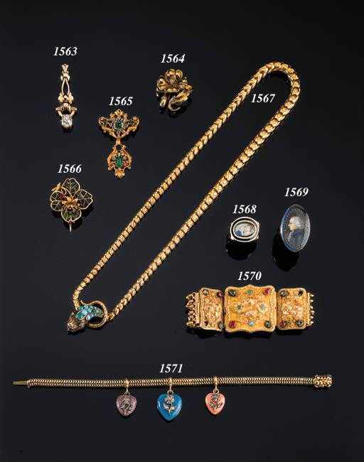 AN ANTIQUE GOLD AND GEM-SET BR