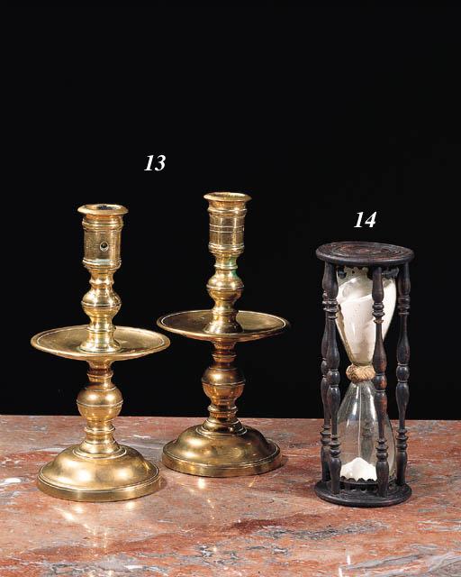 A pair of Dutch brass candlest
