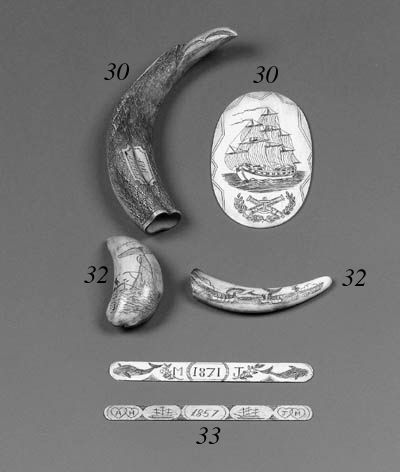 Two scrimshaw-decorated apple