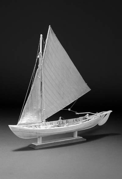 A whale bone model of a gaff r