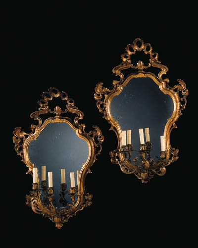 A pair of Italian giltwood thr