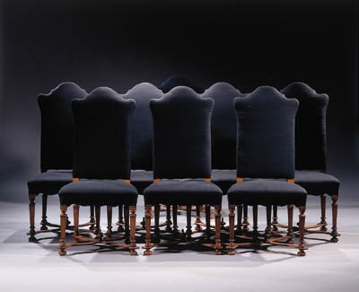 A set of eight walnut chairs