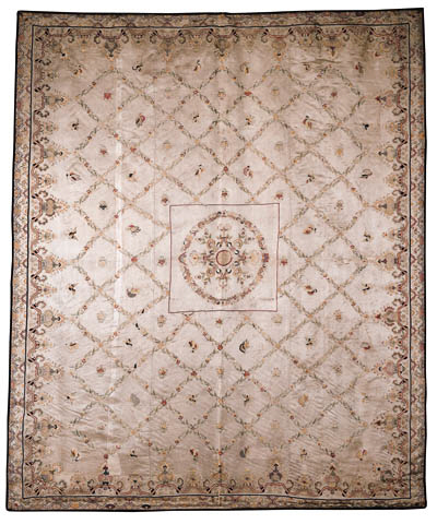 A Chinese silk coverlet