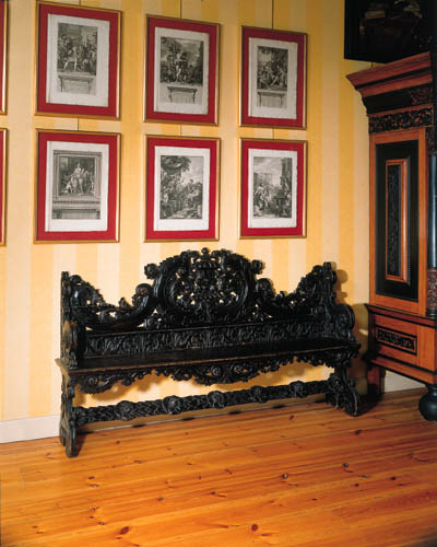 A Dutch ebonised hall bench