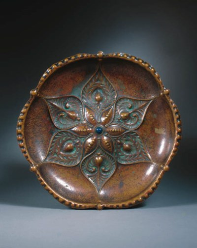 A patinated copper dish