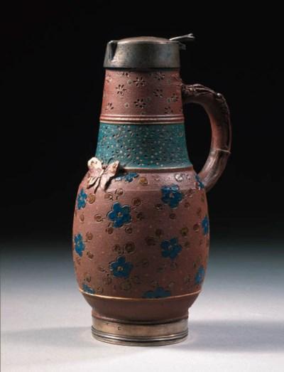 a silver-mounted stoneware jug
