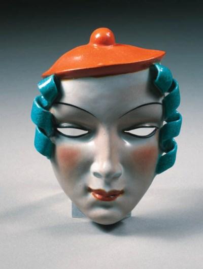 A glazed pottery mask