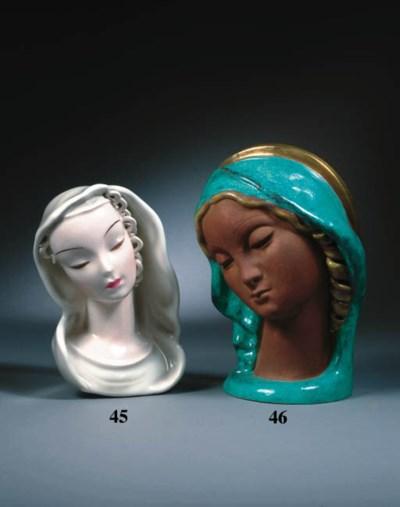 A glazed porcelain head of the
