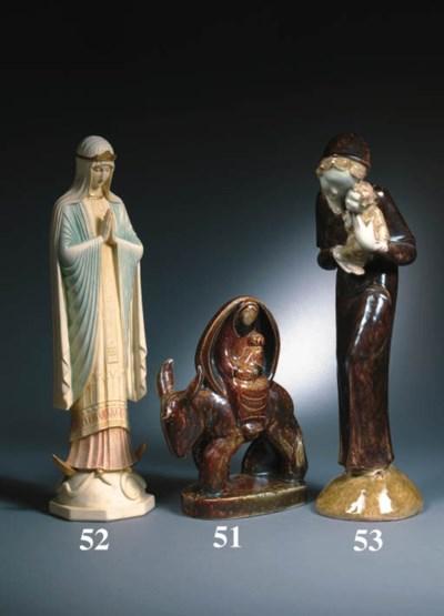 A glazed pottery figure of the