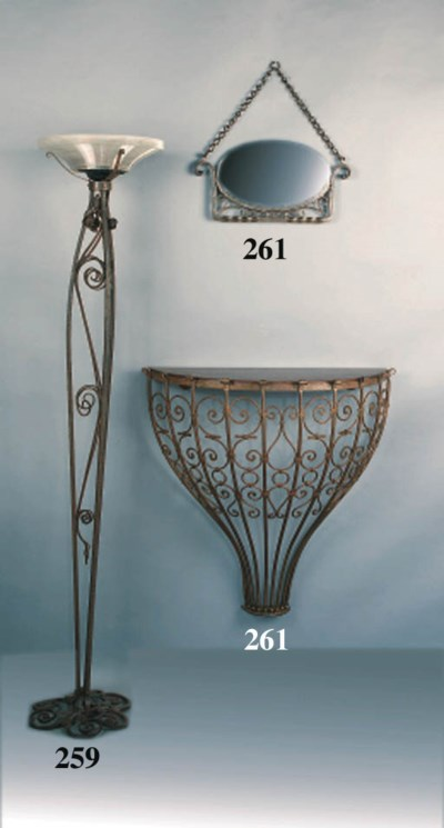 A WROUGHT-IRON DEMILUNE WALL-T