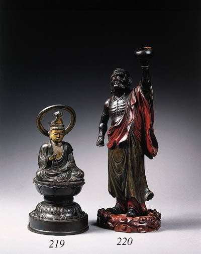 A lacquered wood sculpture of