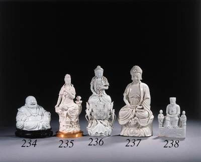 A blanc-de-Chine figure of Bud