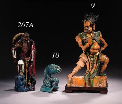 An enamelled Shiwan figure of