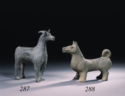 A grey pottery figure of a ram