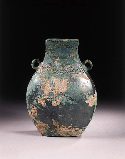 An archaic bronze flattened fa