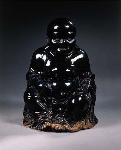 An aubergine-glazed figure of