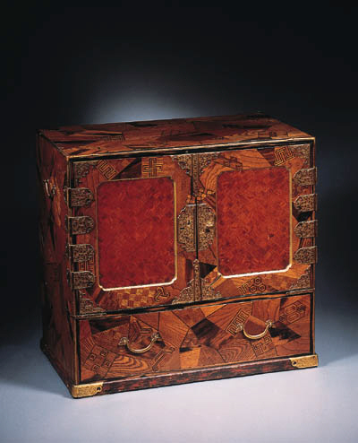 A small marquetry cabinet