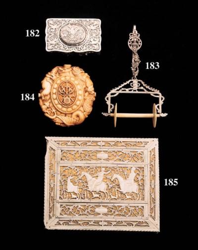 A carved ivory medallion/flask